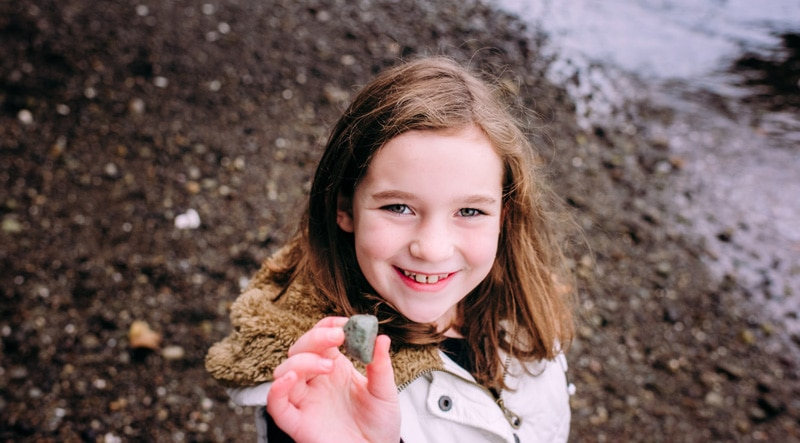 Children Photography - Children Photographer - Little girl holding a rock