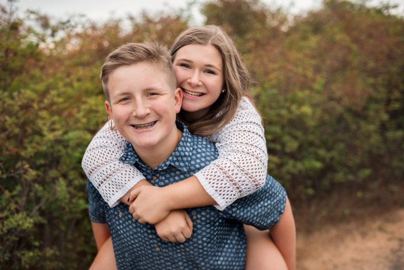 Children Photography - Children Photographer - Girl on boy's back