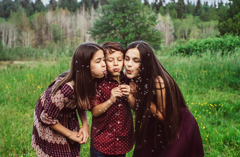 Family Photographer, Family Photography Memories, three siblings blowing on a flower