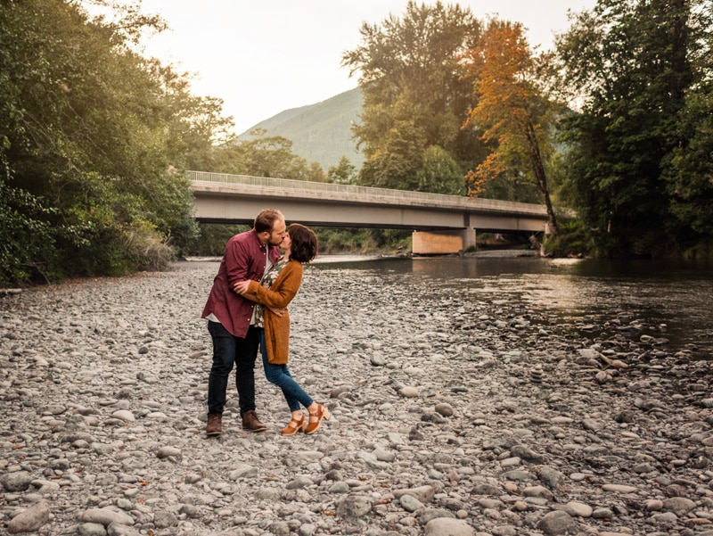 Family Photographer, Family Photography Memories, couple kissing by a bridge