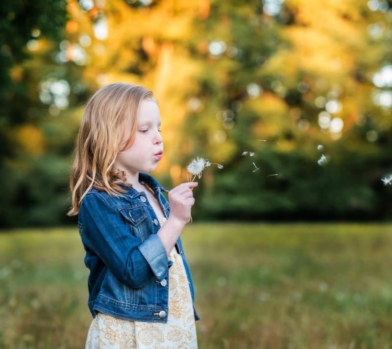 Children Photography - Children Photographer - Girl blowing flower
