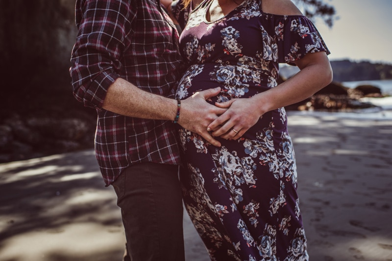 Maternity Photography - Maternity Photographer - Husband has his hand on his wife's belly