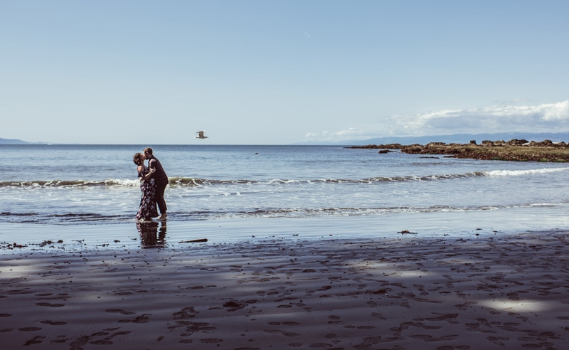 Maternity Photography - Maternity Photographer - husband and wife kissing on the beach