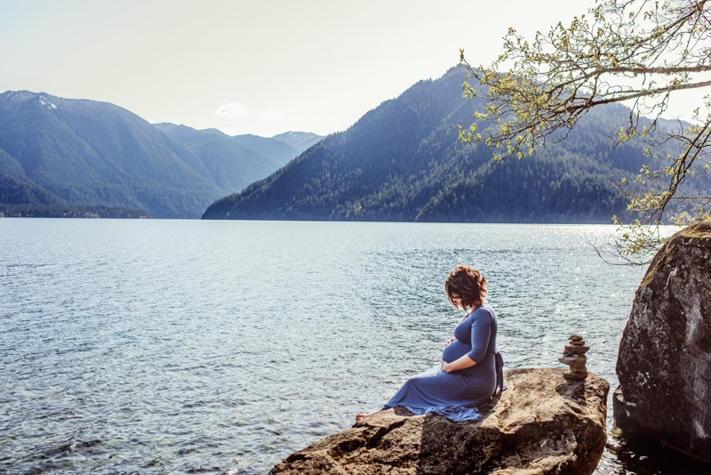 Maternity Photography - Maternity Photographer - Woman in blue dress by the water