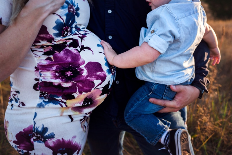 Maternity Photography - Maternity Photographer - Little boy touching his mom's belly