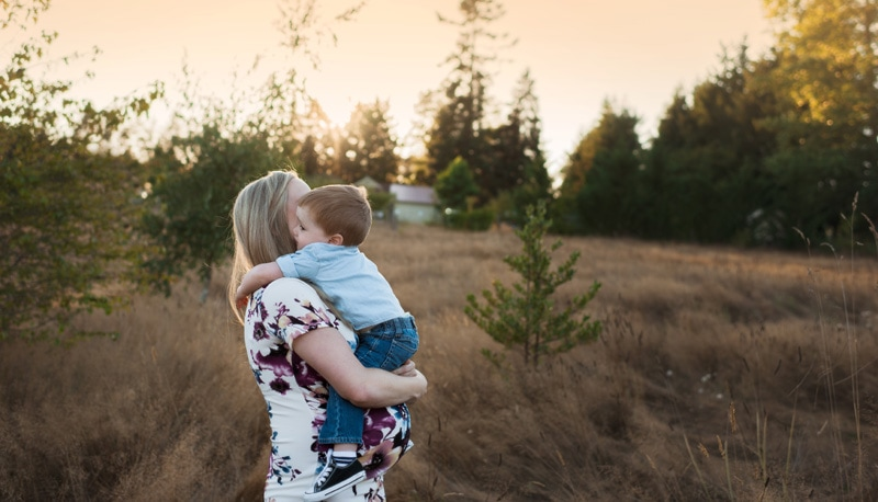 Maternity Photography - Maternity Photographer - Pregnant Woman holding her son