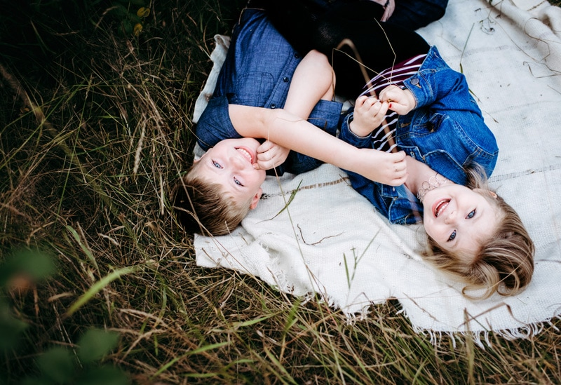 Children Photography - Children Photographer - boy and girl playing on a blanket