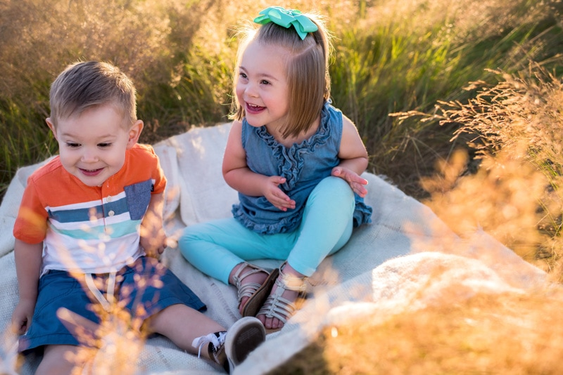 Children Photography - Children Photographer - Boy and girl sitting on a blanket in a field