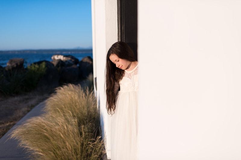 Children Photography - Children Photographer - Girl in white dress standing in a doorway