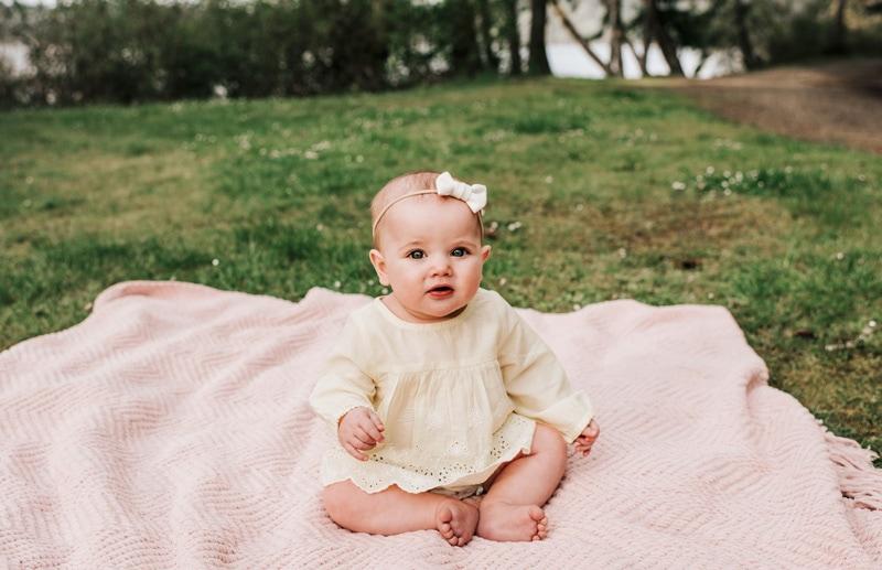 Children Photography - Children Photographer - baby girl sitting on a blanket