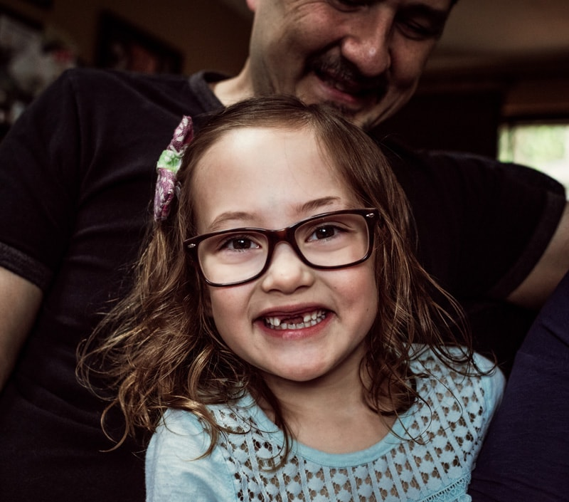 Children Photography - Children Photographer - Little girl with ribbon in her hair and glasses