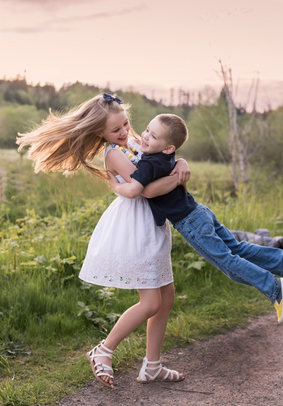 Children Photography - Children Photographer - Sister twirling brother