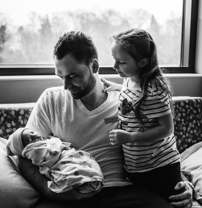 Fresh 48 Photographer, Fresh 48 Photography Memories, black and white father and daughter looking at new baby