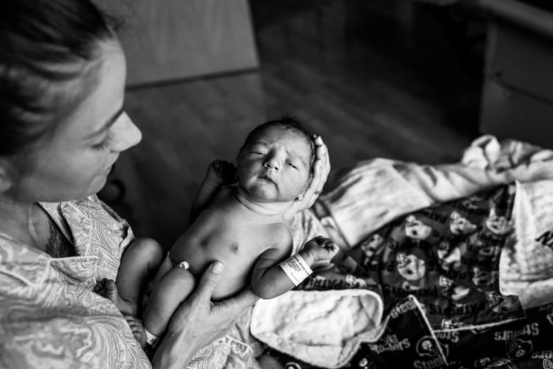 Fresh 48 Photographer, Fresh 48 Photography Memories, mother turning baby's head toward the camera.