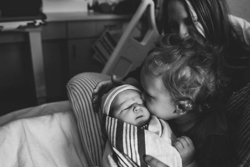 Fresh 48 Photographer, Fresh 48 Photography Memories, black and white of sibling kissing new baby